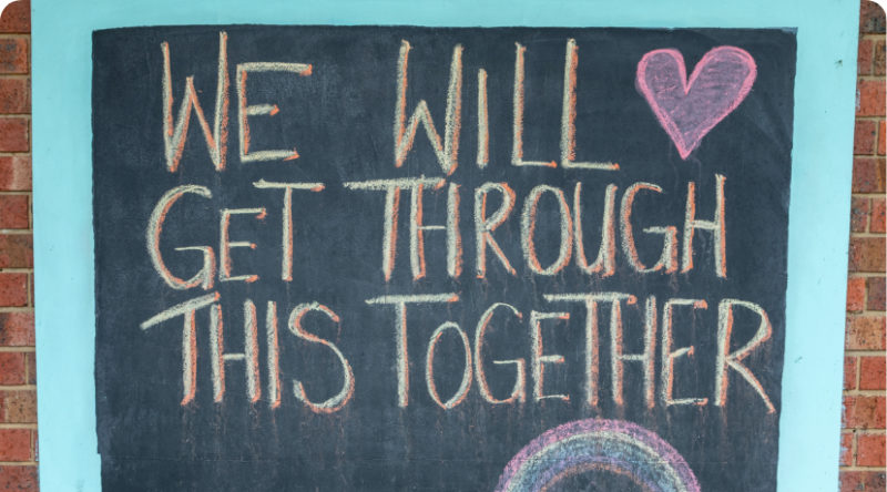 """We will get through this together"" written in chalk"