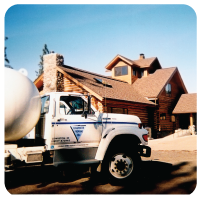 propane truck by a log cabin building