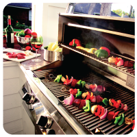 Vegetables cooking on grill outside.